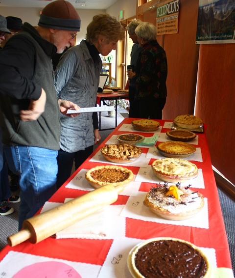 People drooling over the pies to be auctioned