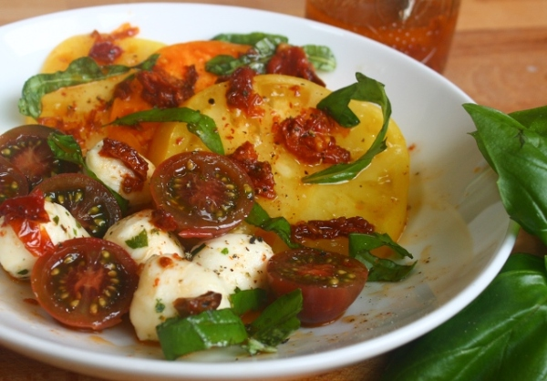 Tomato conserva salad dressing on heirloom tomatoes